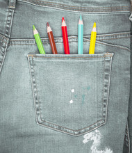 Colored Pencils In The Back Pocket Of Blue Jeans