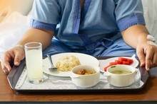 Patient And Hospital Concept - Asia Man Patient With Iv Solution Eating Healthy Food For Patient On Bed In Hospital And Copy Space