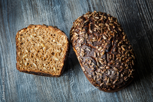 Fotografie, Obraz  whole and half of  delicious homemade rectangular rye bread
