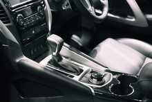Luxury Of Car Interior At Transmission Shift Gear Area. Modern Car Interior, Gearstick Radio And Cup Holder..