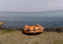 Empty Rubber Dinghy On The Beach