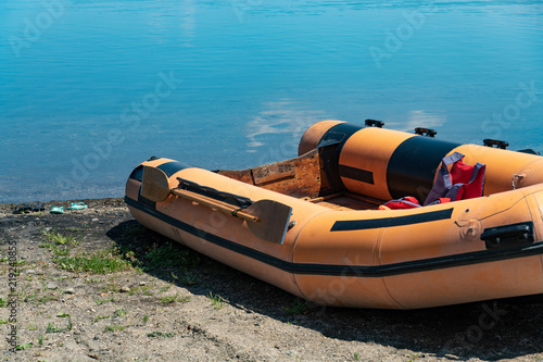 Empty rubber dinghy on the beach Wallpaper Mural