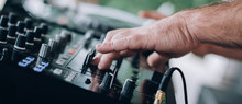 Closeup Of DJ Hands Plays Music On Player And Mixer