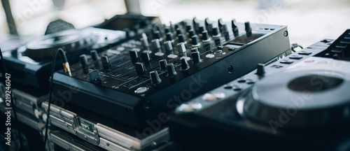Close up of DJ CD player and mixer Fototapet