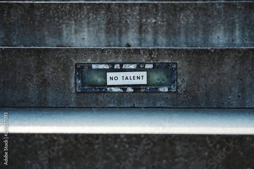 Photo  no talent sign on public stairs