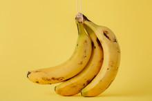 Ripe Bananas On Yellow Backgro...