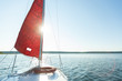 canvas print picture - sailboat with red sail. copy space