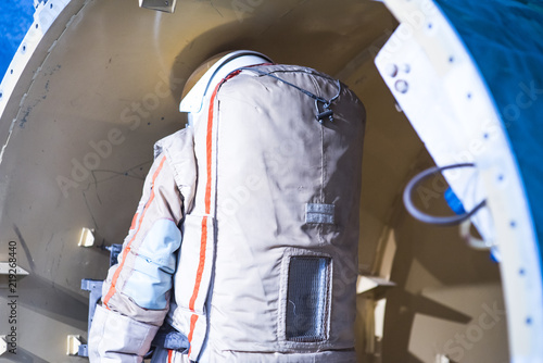 A astronaut and cosmonaut perform work on a space station while deap space.