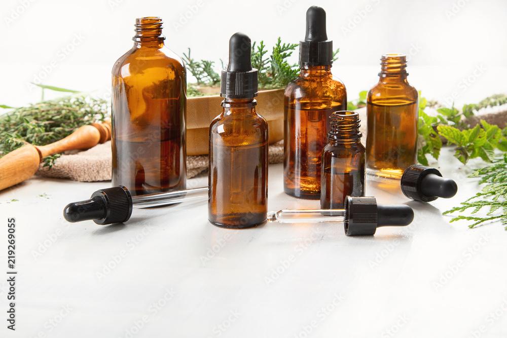 Fototapety, obrazy: Bottles of essential oils