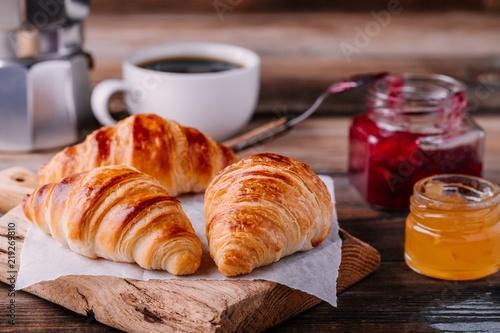 Photo Stands Coffee beans Homemade baked croissants with jam and coffee on wooden rustic background