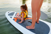 View From Top Of A Little Child In A Life Vest On The Sup Board