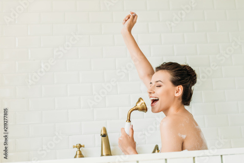 Valokuva  beautiful happy girl singing and having fun in bathtub