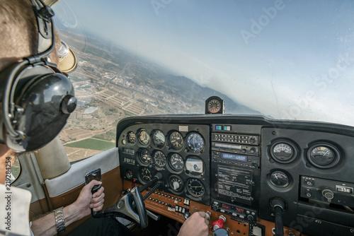 Pilot flying light aircraft. Canvas Print