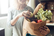 Leinwanddruck Bild - Closeup of Smiling Girl holds Bag of Healthy Food