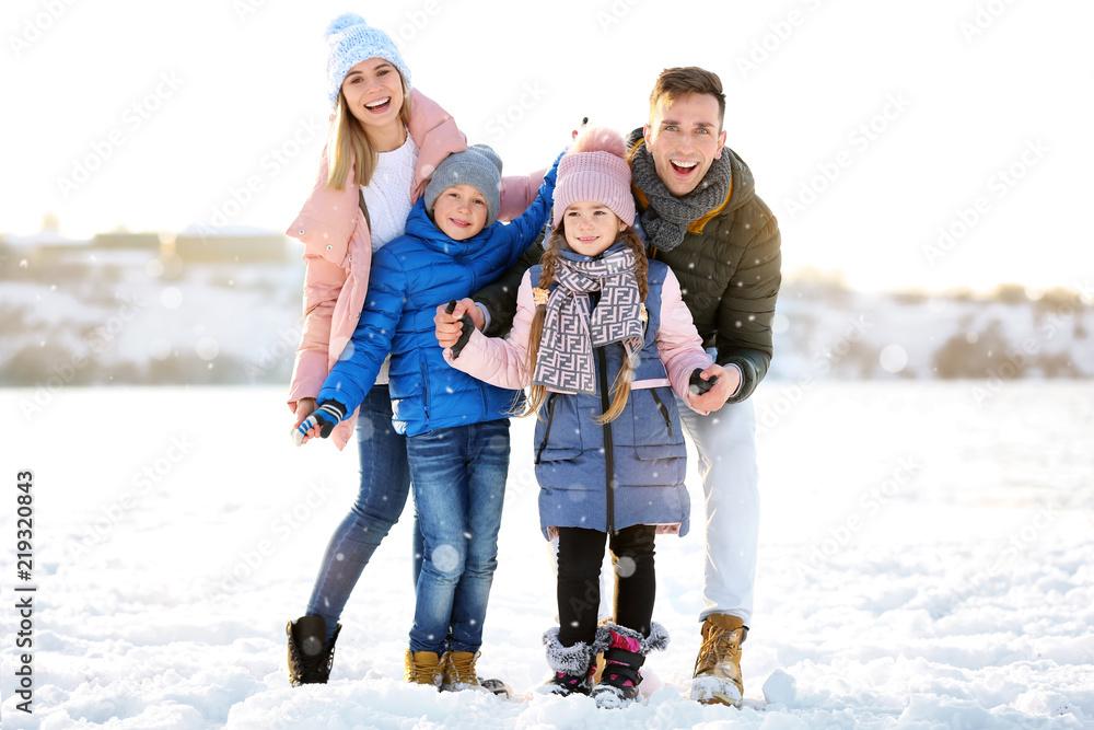 Fototapeta Portrait of happy family outdoors on winter day