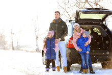 Happy Family Near Car On Winter Day
