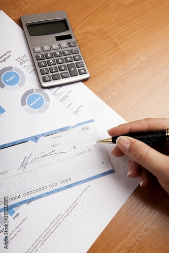 Woman's Hand Writing a Check - Close Up - 219322071
