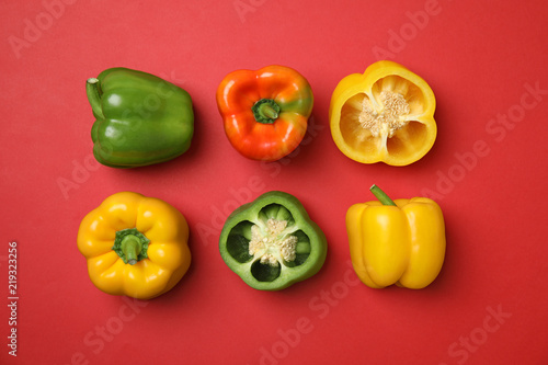 Flat lay composition with raw ripe paprika peppers on color background Canvas Print