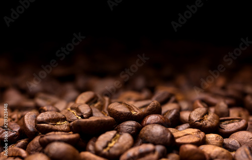 Roasted coffee beans on dark background - 219323448