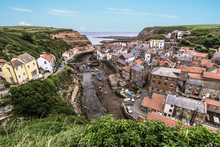 The North Yorkshire Coastal Villages Of Staithes (right Hand Side)and Cowbar (left Hand Side).