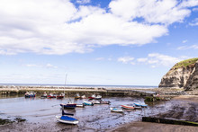 Staithes, North Yorkshire, UK.  A View Of Staithes Harbour And The Penny Nab Headland.
