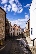 Staithes, North Yorkshire, UK.  A View Looking Down High Street Towards The Harbour.