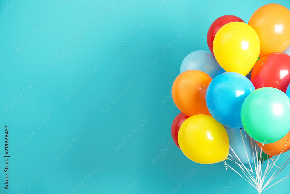 Fototapeta Bunch of bright balloons and space for text against color background