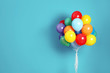 Leinwanddruck Bild - Bunch of bright balloons and space for text against color background