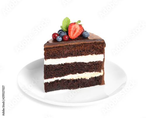Fényképezés Plate with slice of chocolate sponge berry cake on white background