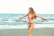 Happy young woman at beach in summer vacation.