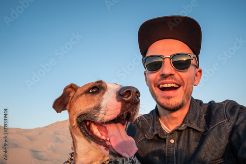 Valokuvatapetti Funny best friends concept: human taking a selfie with dog