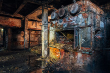 Old Brick Industrial Stove In Abandoned Boiler Room In Factory