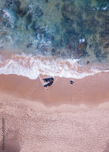 Aerial view of waves on the beach