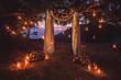 Leinwandbild Motiv Night wedding ceremony with a lot of lights, candles, lanterns. Beautiful romantic shining decorations in twilight