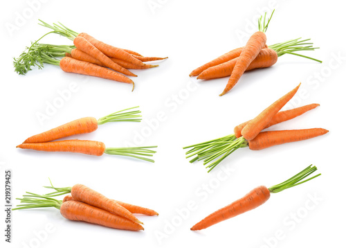 Set with fresh ripe carrots on white background