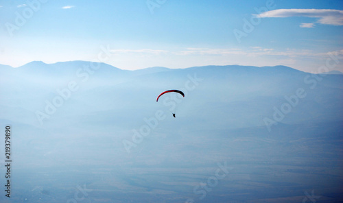 Paraglider in the sky above the ground