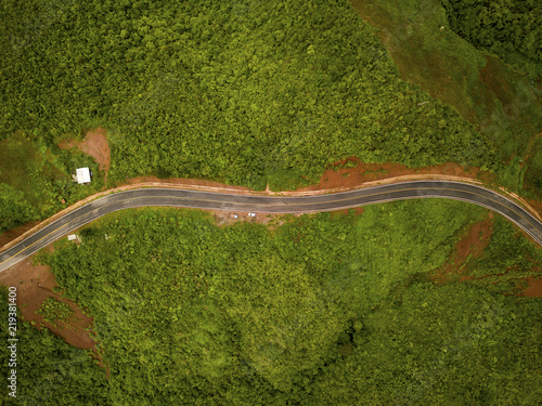 Fototapety, obrazy: Aerial view of countryside road passing through the lush greenery and foliage tropical rain forest mountain landscape in the Northern Thailand
