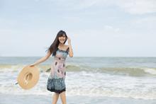 Beautiful Girl Enjoy And Happy On The Beach, Hua Hin, Thailand .