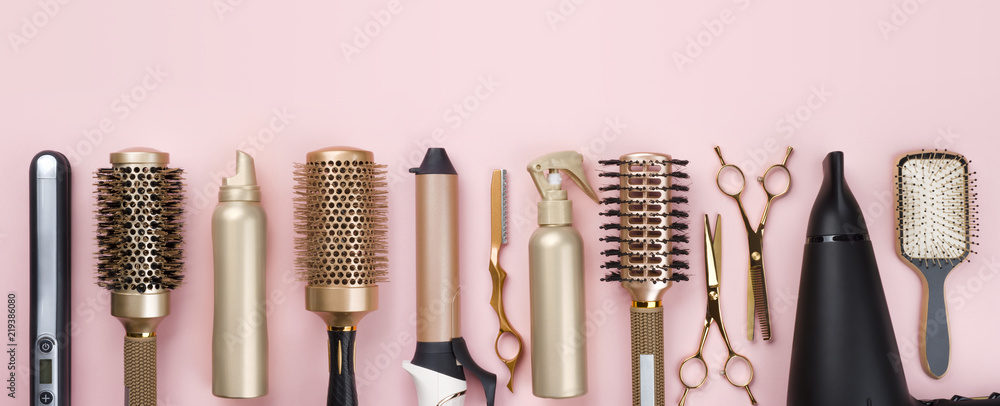 Fototapeta Professional hair dresser tools on pink background with copy space