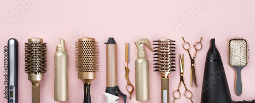 Obraz Professional hair dresser tools on pink background with copy space - fototapety do salonu