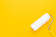Leinwanddruck Bild - clean paint roller on the yellow background with copy space