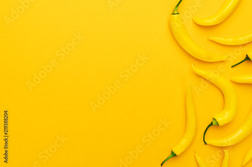 Photo  yellow hot chilli peppers with copy space
