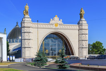 Pavilion Space On Exhibition Of Achievements Of National Economy (VDNH) In Moscow On A Blue Sky Background In Sunny Summer Morning
