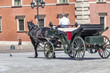 Horse carriage at Castle Square in the Old Town of Warsaw, Poland