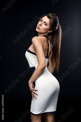 Studio Portrait Of Sexy Brunette Girl In White And Black Fit Dress