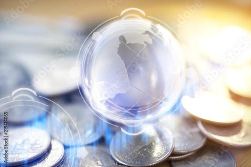 Fotografie, Obraz  Gold Globe with many gold coins around..
