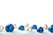 Blue And Silver Christmas Ornaments On White Background