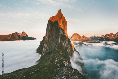 In de dag Groen blauw Segla Mountain sunset peak Landscape over clouds and fjord view in Norway Travel location scenery Senja islands midnight sun