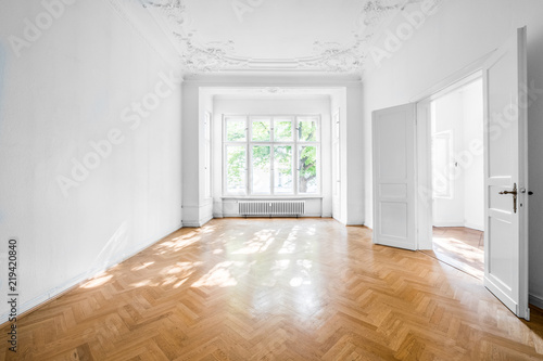 room in old apartment building with wooden parquet floor - real estate interior Canvas Print