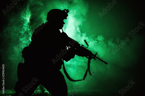 Fényképezés  Silhouette of modern infantry soldier, elite army fighter in tactical ammunition